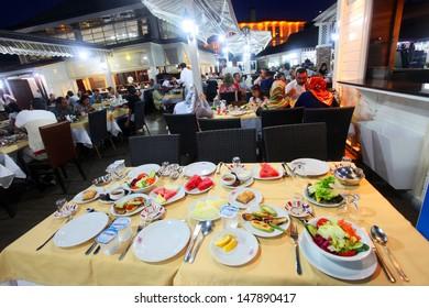 ISTANBUL, TURKEY - AUGUST 8: Traditional Turkish 'Sahur' table near the Eyup Sultan Mosque at Ramadan on August 8, 2011 in Turkey.