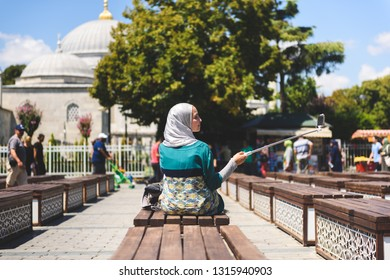 ISTANBUL, TURKEY, AUGUST 9, 2018: beautiful unidentified islamic woman with Hijab make a selfy in front of a mosque in Istanbul