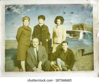 ISTANBUL, TURKEY - CIRCA 1960's :Turkish family looking at camera.CIRCA 1960's