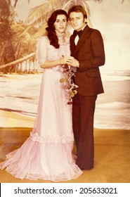ISTANBUL, TURKEY, CIRCA 1970s:  A vintage photo of a young couple on their wedding day.Istanbul, Turkey, circa 1970s.