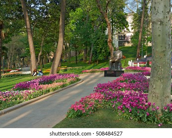 ISTANBUL, TURKEY -- CIRCA APRIL 2014: Ataturk Monument among blooming tulips at the entrance to Gulhane Park