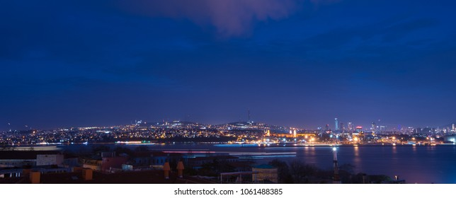 Istanbul, Turkey - Circa December 2017 - A night shot of part of Istanbul, Turkey cityscape with beautiful lighting and the reflection from the Golden Horn waterway