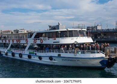 Istanbul, Turkey - Circa December 2017 - A shot of a ferry from Kadiköi full of an unidentified passengers approaching Karaköy in Istanbul, Turkey