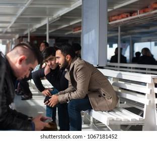 Istanbul, Turkey - Circa December 2017 - A shot of an unidentified ferry passengers on board from Karaköy to Kadiköy, Istanbul, Turkey