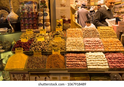 Istanbul, Turkey - Circa December 2017 - A shot of an unidentified store owners selling various spices in Spice Bazaar, Istanbul, Turkey to unidentified tourists and visitors