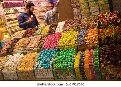 Istanbul, Turkey - Circa December 2017 - A shot of an unidentified store owner selling colorful sweets and candies in Spice Bazaar, Istanbul, Turkey