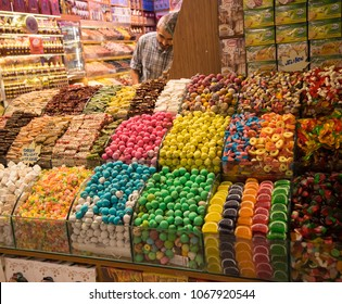 Istanbul, Turkey - Circa December 2017 - A shot of an unidentified store owner selling colourful sweets and candies in Spice Bazaar, Istanbul, Turkey