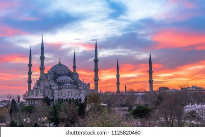 Istanbul, Turkey - Circa December 2017 - The exterior shot of the Suktan Ahmet Mosque aka Blue Mosque during sunset taken from the rooftop of a nearby hotel in Istanbul, Turkey