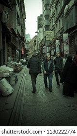 Istanbul, Turkey - Circa December 2017 - A street photography shot with an unidentified local Turkish men and women strolling along an alley in Istanbul, Turkey