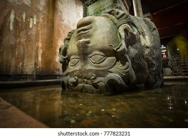 Istanbul, Turkey - Circa December 2017 - A close up shot of the column with Medusa head base in the Basilica Cistern aka Yerebatan Sarnici which lie beneath the city of Istanbul