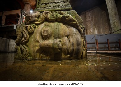Istanbul, Turkey - Circa December 2017 - The close up shot of the Medusa head base column in the Basilica Cistern aka Yerebatan Sarnici that lie beneath the city of Istanbul, Turkey