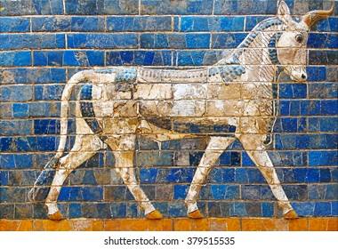 ISTANBUL, TURKEY - CIRCA OCTOBER 2008: Ancient Babylonian mosaic on the Ishtar Gate wall with mythical bull, Archaeological museum, Istanbul, Turkey.