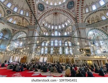 ISTANBUL, TURKEY - DEC 3, 2017: Friday pray in congregation male Muslims Fatih Mosque on December 3, 2017 in Istanbul, Turkey.