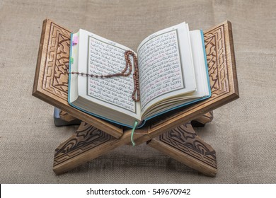 Istanbul, Turkey - December 03, 2016 ; Holy Quran and prayer beads on stand.