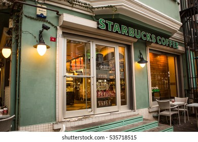 ISTANBUL, TURKEY, DECEMBER 13, 2016: Starbucks coffeehouse on a Ortakoy Square , Istanbul, Turkey, December 13, 2016. There are more and more people enjoying coffee here in Istanbul