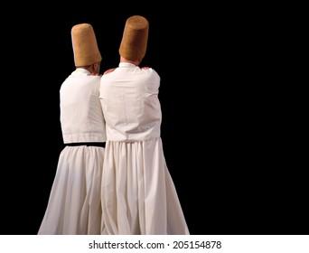 ISTANBUL, TURKEY - DECEMBER 14: Sufi whirling dervish (Semazen) dances, Commemoration of Mevlana Jalaluddin Rumi on December 14, 2013 in Istanbul. Semazen conveys God's spiritual gift to ritual.