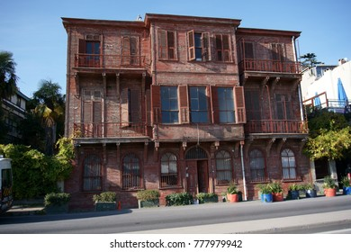 Istanbul, Turkey December 15, 2017: Red Coloured Wooden Mansion by Bosphorous