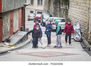 ISTANBUL, TURKEY - December 2016: Turkish children playing football on the street in old Istanbul area Balat, Turkey