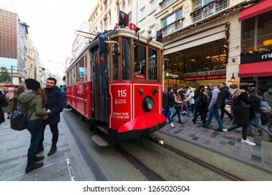 ISTANBUL, TURKEY - DECEMBER 22, 2018: Nostalgic Red Tram of Istanbul. Historic tram in Taksim Istiklal Street. Touristic popular destination Taksim Istiklal Street. Beyoglu, Istanbul, Turkey.