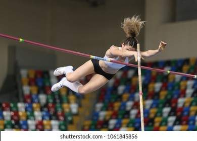 ISTANBUL, TURKEY - DECEMBER 23, 2017: Undefined athlete pole vaulting during Turkish Athletic Federation Indoor Athletics Record Attempt Races