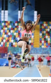 ISTANBUL, TURKEY - DECEMBER 24, 2016: Athlete Melek Zubeyde Sahinoglu Long Jumping during Turkish Athletic Federation Indoor Athletics Record Attempt Races