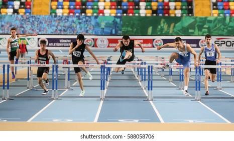 ISTANBUL, TURKEY - DECEMBER 25, 2016: Athletes running 60 metres hurdles during Turkish Athletic Federation Indoor Athletics Record Attempt Races