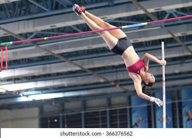 ISTANBUL, TURKEY - DECEMBER 26, 2015: Athlete Demet Parlak pole vaulting during Turkish Athletic Federation Indoor Athletics Record Attempt Races
