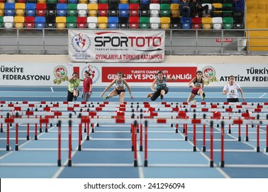 ISTANBUL, TURKEY - DECEMBER 28, 2014: Athletes run steeplechase during Athletics record attempt races in Asli Cakir Alptekin Athletics hall, Istanbul.