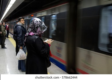 ISTANBUL, TURKEY - DECEMBER 28, 2015 : People waiting to board a Marmaray train. Opened in 2013, Marmaray train line connects the Asian and European sides of Istanbul through a tunnel under Bosphorus