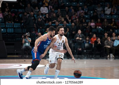 Istanbul / Turkey - December 7, 2018: Vasilije Micic and Sergio Llull in action during EuroLeague 2018-19 Round 2 basketball game Anadolu Efes vs Real Madrid at Sinan Erdem Dome.