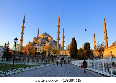 Istanbul, Turkey - DECEMBER 8 2013: Tourists visiting the Sultan Ahmed Mosque or Blue Mosque in the morning