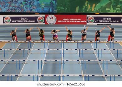 ISTANBUL, TURKEY - FEBRUARY 02, 2020: Athletes running 60 metres hurdles during Turkish Indoor Athletics Championships