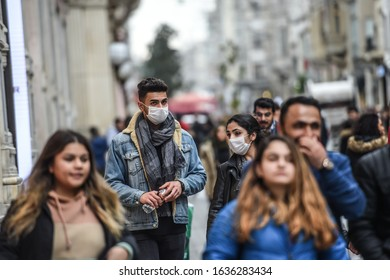 ISTANBUL, TURKEY - FEBRUARY 05, 2019: People are wearing protective masks as they walks in Istiklal street in Istanbul.