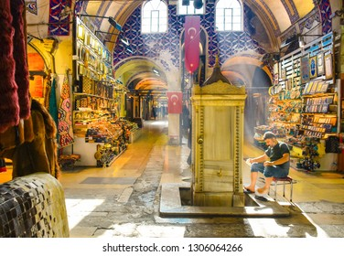 ISTANBUL, TURKEY - FEBRUARY 1, 2019: Muslim man washing himself before prayer. Old traditional ablution fountain in the Grand Bazaar. Grand Bazaar one of the most popular shopping place among tourists