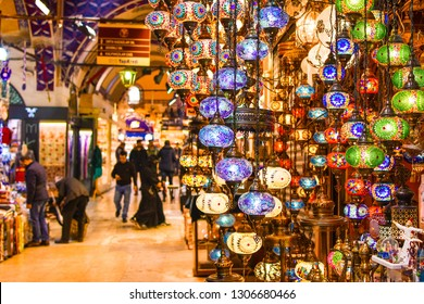 ISTANBUL, TURKEY - FEBRUARY 1, 2019: Shopping in the Grand Bazar. Traditional Turkish lamps in souvenir shop. Handmade mosaic of colored glass in Grand Bazaar.