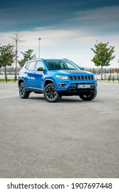 Istanbul, Turkey - February 1 2021 : Jeep Compass is a compact crossover SUV. All wheel drive hybrid car is parked for photoshoot.