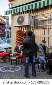 Istanbul, Turkey - February 12 2013: A man is selling the traditional circular bred to people (Istanbul Asian side)