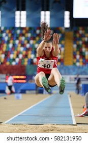 ISTANBUL, TURKEY - FEBRUARY 12, 2017: Athlete Martina Miroska long jumping during Balkan Junior Indoor Championships