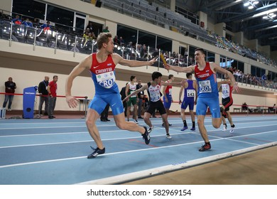 ISTANBUL, TURKEY - FEBRUARY 12, 2017: Athletes running 4x400 metres during Balkan Junior Indoor Championships