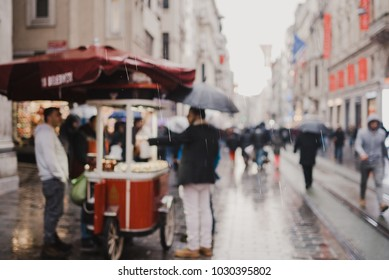 ISTANBUL, TURKEY - FEBRUARY 14, 2018: People of Istanbul are walking in a rainy day in Taksim, Istanbul,Turkey