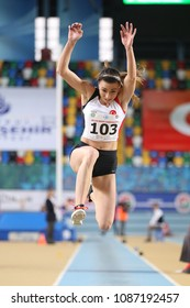 ISTANBUL, TURKEY - FEBRUARY 17, 2018: Undefined athlete triple jumping during Balkan Athletics Indoor Championships