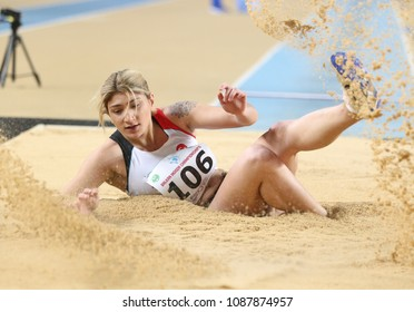 ISTANBUL, TURKEY - FEBRUARY 17, 2018: Undefined athlete long jumping during Balkan Athletics Indoor Championships