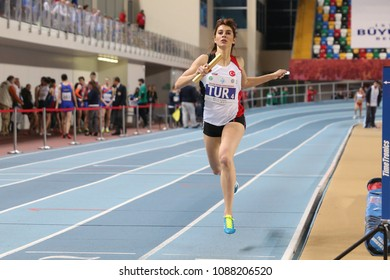 ISTANBUL, TURKEY - FEBRUARY 17, 2018: Undefined athlete running 4x400 metres during Balkan Athletics Indoor Championships