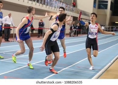 ISTANBUL, TURKEY - FEBRUARY 17, 2018: Athletes running 4x400 metres during Balkan Athletics Indoor Championships