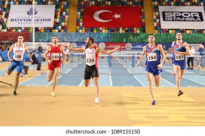 ISTANBUL, TURKEY - FEBRUARY 17, 2018: Athletes running 60 metres hurdles during Balkan Athletics Indoor Championships