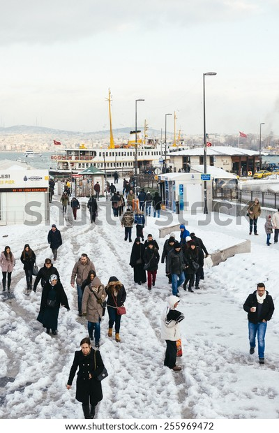 ISTANBUL, TURKEY - FEBRUARY 19, 2015: istanbul winter a day.Turkish people walking in Eminonu district on a snowy day