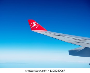 Istanbul, Turkey - February 19, 2019: Wing of a Turkish Airlines passenger aircraft in flight