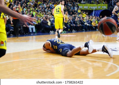 ISTANBUL / TURKEY - FEBRUARY 20, 2020: Walter Tavares lying in pain during EuroLeague 2019-20 Round 24 basketball game between Fenerbahce and Real Madrid at Ulker Sports Arena.