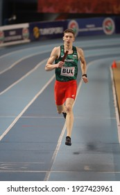 ISTANBUL, TURKEY - FEBRUARY 20, 2021: Undefined athlete running 4x400 metres relay during Balkan Athletics Indoor Championships