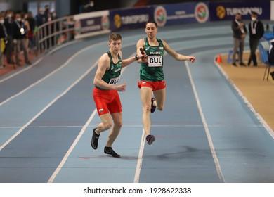 ISTANBUL, TURKEY - FEBRUARY 20, 2021: Athletes running 4x400 metres relay during Balkan Athletics Indoor Championships